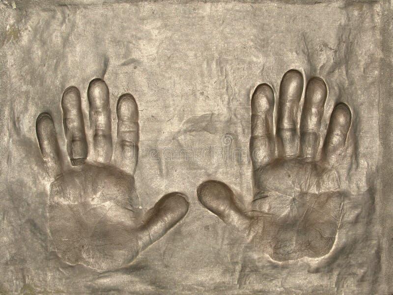 Bronze hands impression royalty free stock image