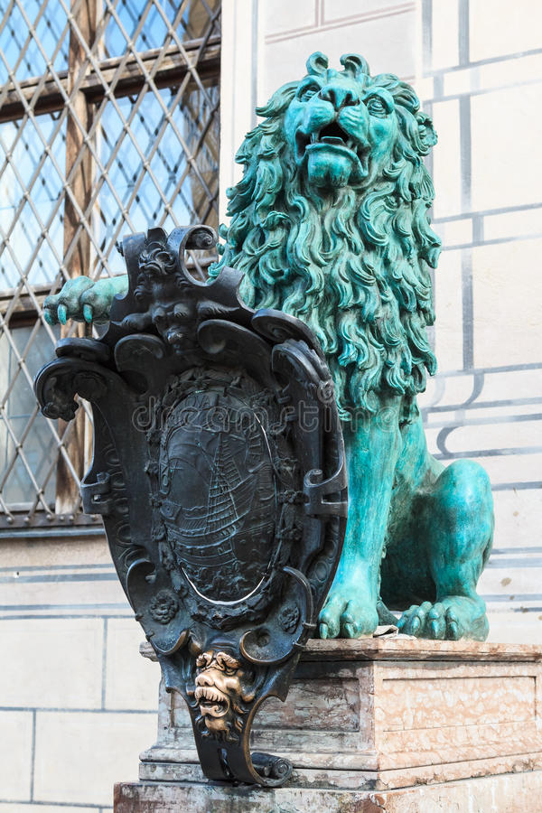 Bronze heraldic lion in Munich. Bronze heraldic lion in front of a royal building named Alte Residenz in Munich, Germany royalty free stock image