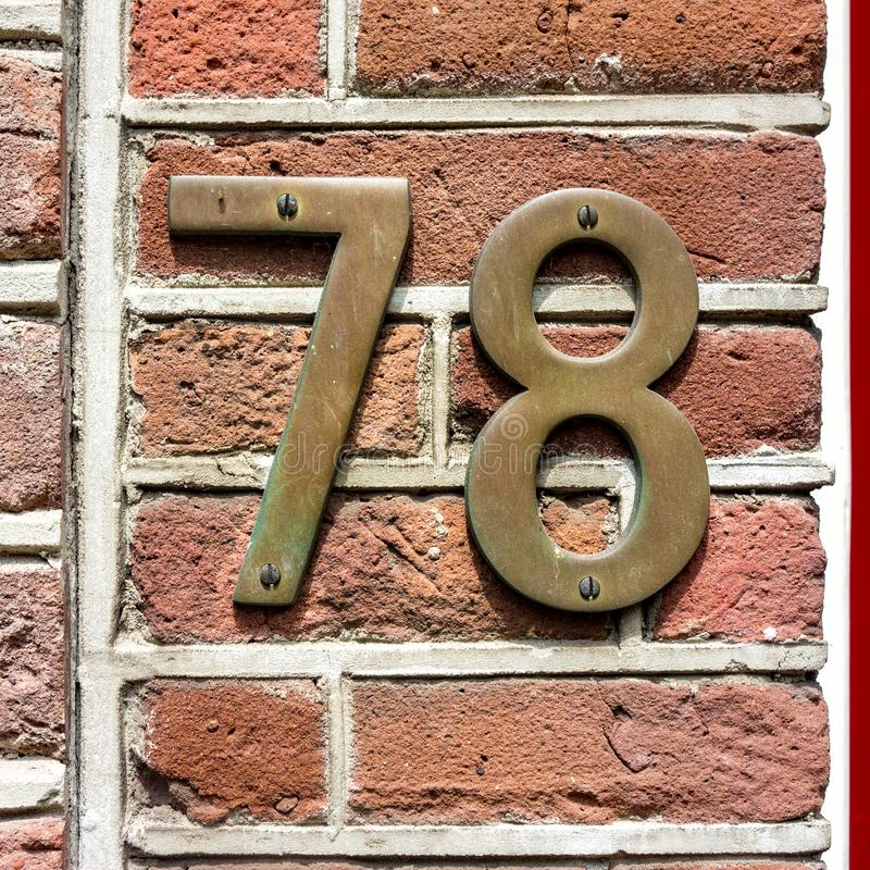 Free Bronze Hous Number Seventy Eight 78 Stock Photography - 116346182