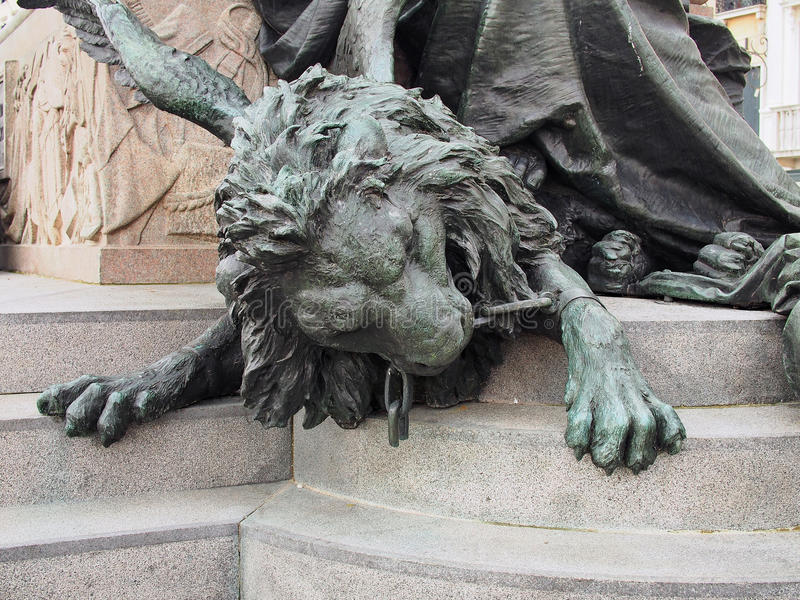 Bronze Lion, Saint Mark`s Square, Venice, Italy. Detail of a bronze lion statue, symbolically chewing through the chains of Austrian oppression, in St Mark`s royalty free stock images