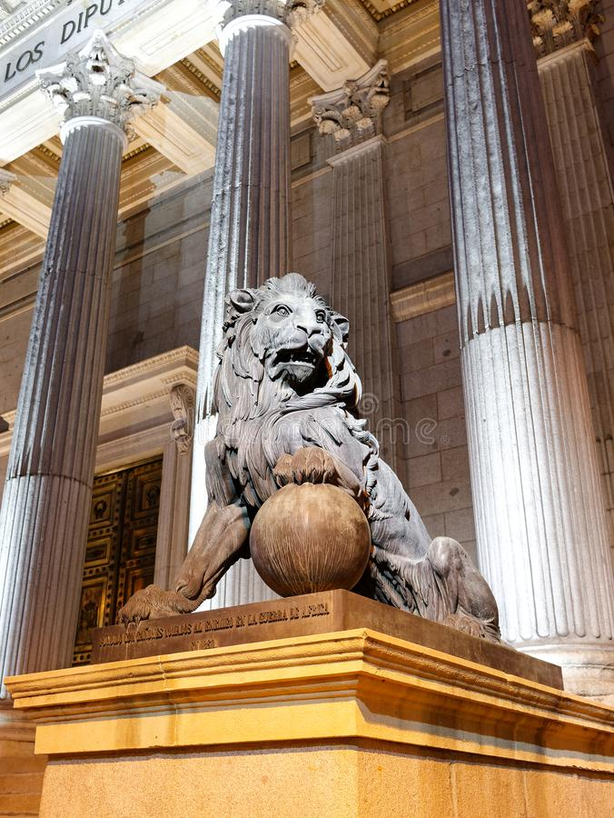 Bronze lion statue at Congreso de los deputados congress of deputies Madrid Spain at night.  royalty free stock image