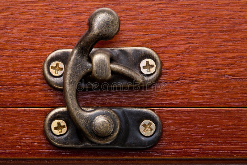 Bronze lock. Of a wooden red chest royalty free stock photos