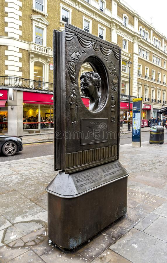 A bronze made memorial of Agatha Christie and street view in the Theatre district, London, United Kingdom. October 2017 stock photo