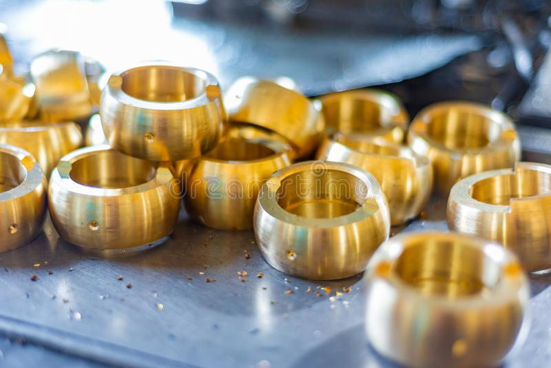 Bronze milling rings, parts after processing on a CNC machine royalty free stock photo