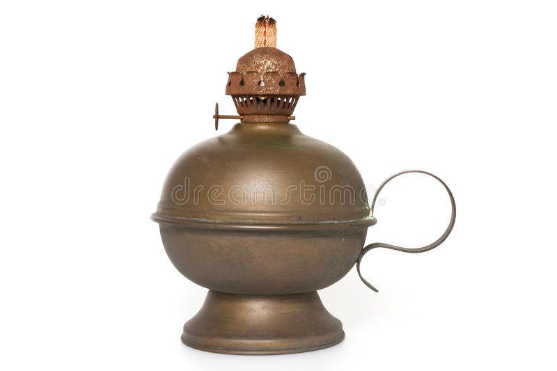 Bronze oil lamp. An old bronze oil lamp with wick isolated on a white background stock images