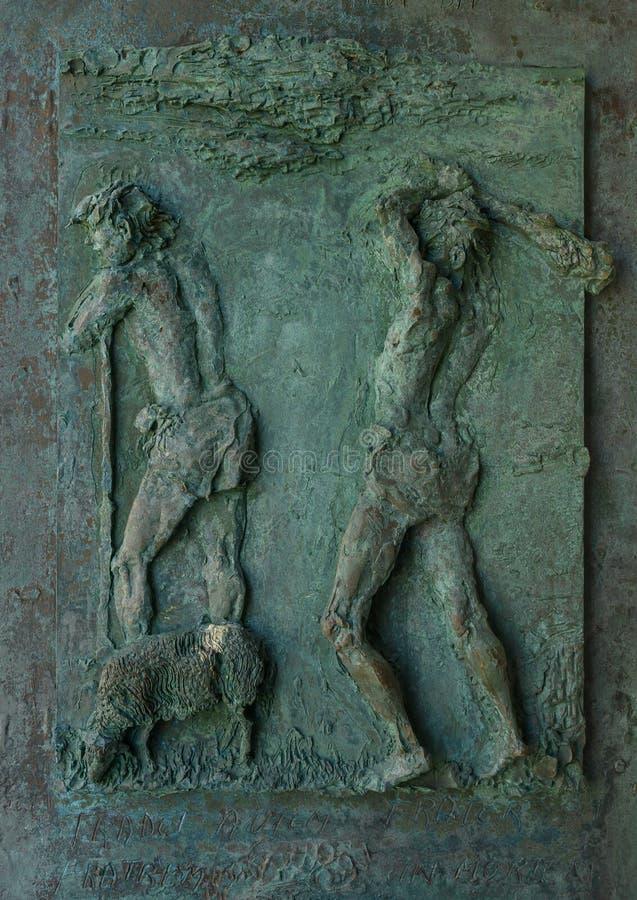 Bronze relief on door panel, Church of San Giorgio atop a hill in Portofino, Italy. royalty free stock photography