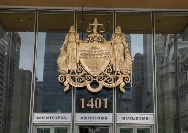 Bronze relief of the Official Seal of Philadelphia above the entrance to the Municipas Services Building. royalty free stock photography