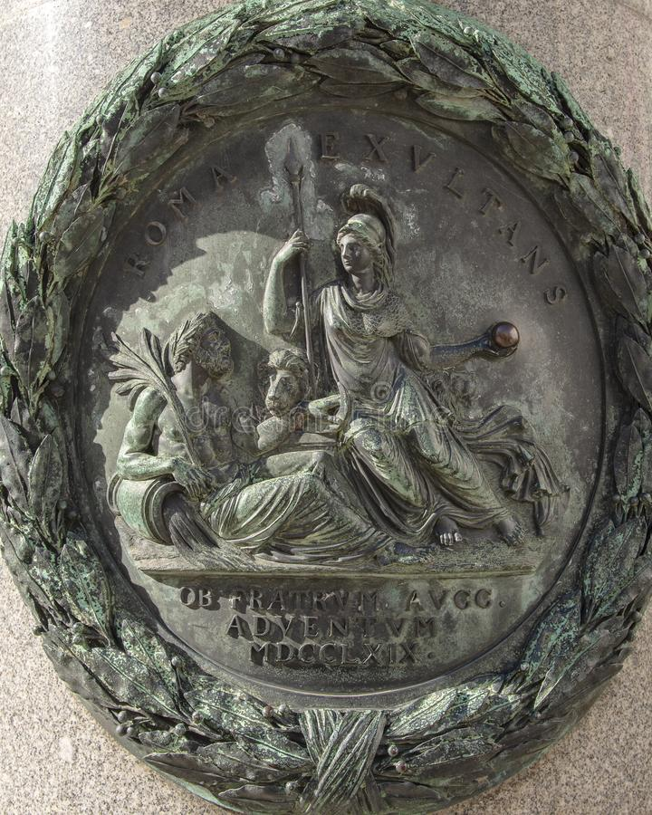 Bronze relief on one of four pillars surrounding the pedestal of the Equestrian statue of Emperor Joseph II, Josefsplatz, Vienna. Pictured is detail in a bronze royalty free stock photo