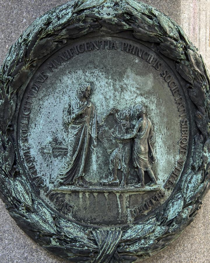 Bronze relief on one of four pillars surrounding the pedestal of the Equestrian statue of Emperor Joseph II, Josefsplatz, Vienna. Pictured is detail on a bronze royalty free stock photo