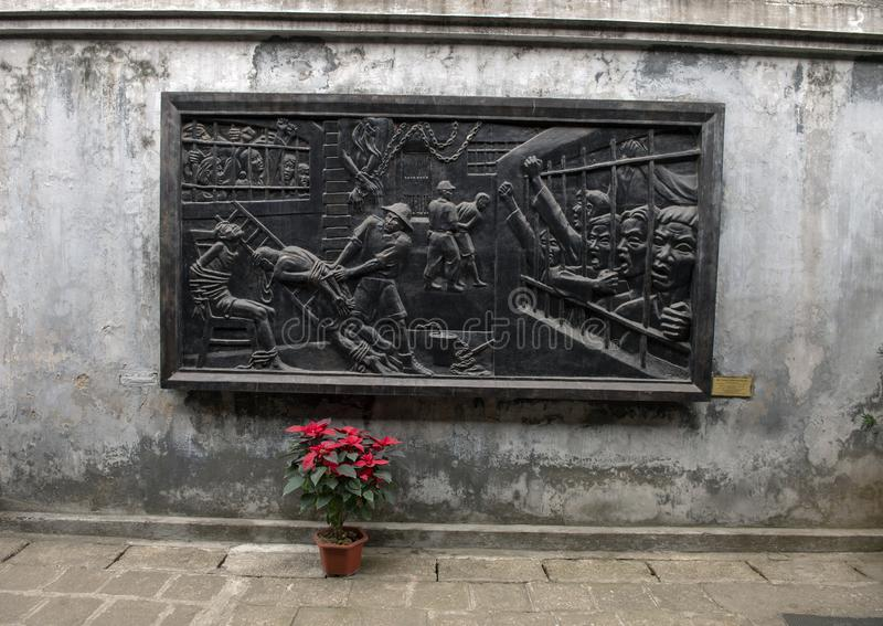 Bronze relief of Vietnamese prisoners in Hoa Lo Prison struggling against the terrorism of the French stock photos