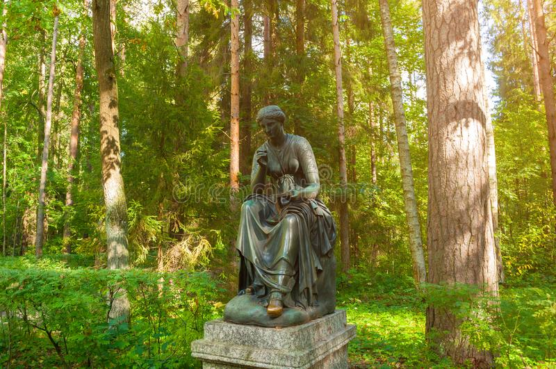 Bronze sculpture of Calliope - the muse of epic poetry and knowledge. Old Silvia park in Pavlovsk, St Petersburg, Russia stock photos