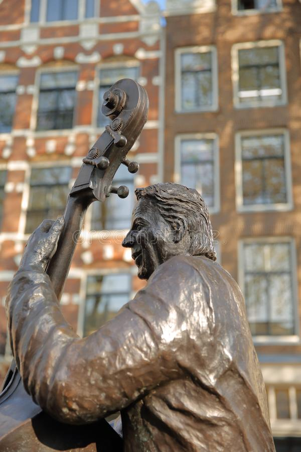 Bronze Sculpture of famous Dutch musician and singer Manke Nelis, located on Elandsgracht close to Prinsengracht canal. AMSTERDAM, NETHERLANDS - APRIL 05, 2019 royalty free stock image