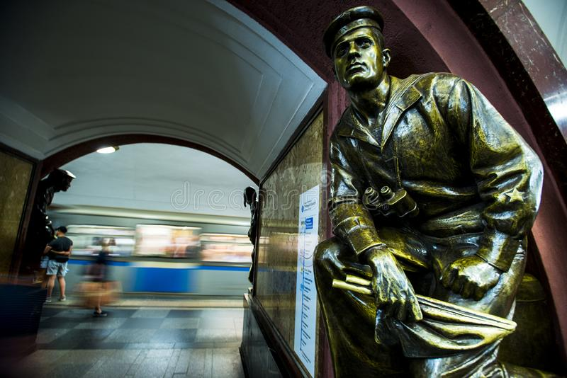 Bronze sculpture in the famous russian revolution metro station, moscow, russia. Bronze sculpture at the Metro station Revolution Square Ploshad Revolutsi royalty free stock image