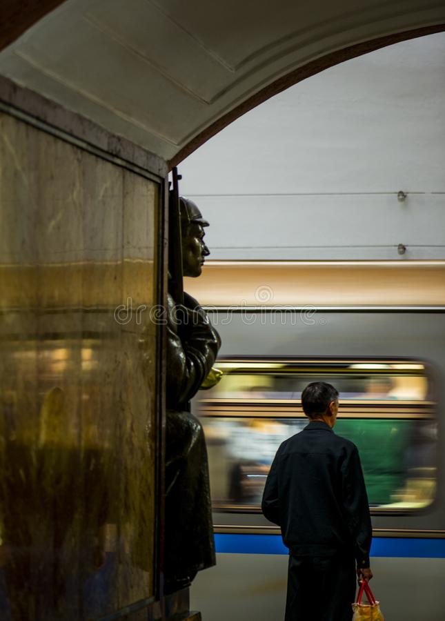 Bronze sculpture in the famous russian revolution metro station, moscow, russia stock photography