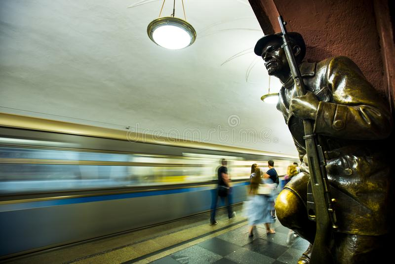 Bronze sculpture in the famous russian revolution metro station, moscow, russia stock image