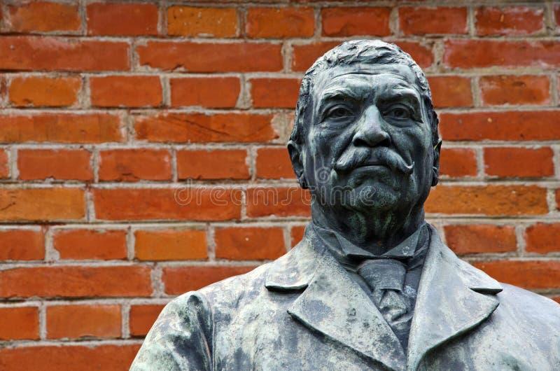 Bronze sculpture of a man with moustache