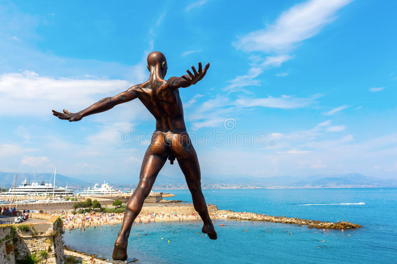 Bronze sculpture of Nicolas Lavarenne in Antibes, France. Antibes, France - July 24, 2016: bronze sculpture in Antibes. It is an outdoor exhibition in the city royalty free stock image