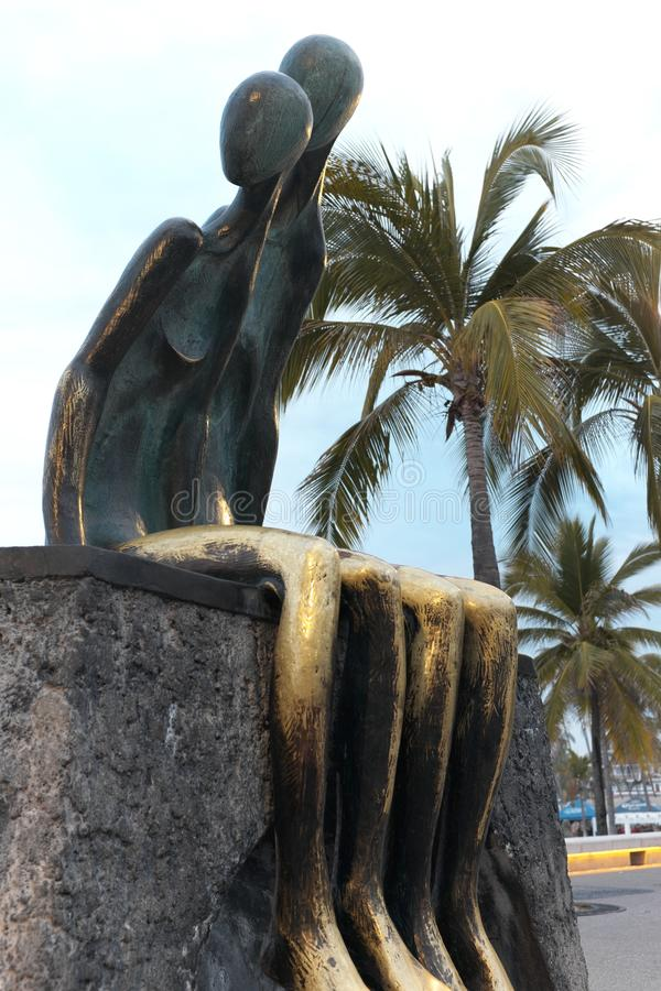 `Nostalgia` by Mexican artist Ramiz Barquet is an iconic statue on the Puerto Vallarta, Mexico malecon. royalty free stock images