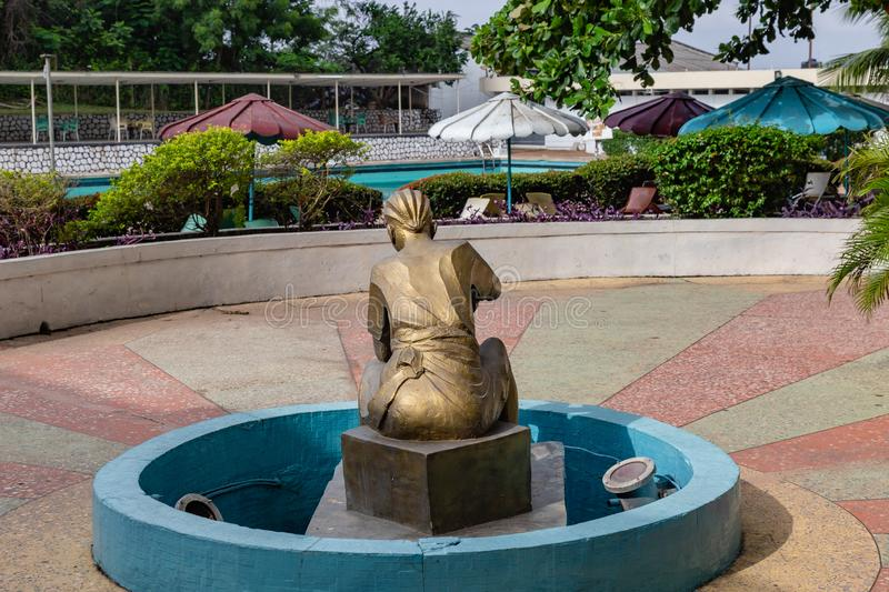 Bronze sculpture of a woman dressed in Yoruba attire with hair braid in Premier Hotel Ibadan Nigeria West Africa. Bronze sculpture of a woman dressed in Yoruba royalty free stock images