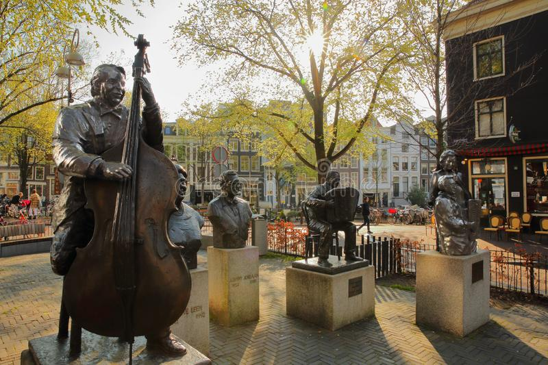 Bronze Sculptures of famous Dutch musicians and singers, located on Elandsgracht close to Prinsengracht canal. AMSTERDAM, NETHERLANDS - APRIL 05, 2019: Bronze stock image