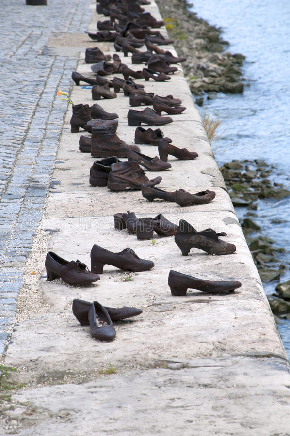 Bronze Shoes by the River Danube in Hungary. Bronze shoes on the quayside of the River Danube in Budapest to remember the deportation of Hungarian Jews to the royalty free stock image