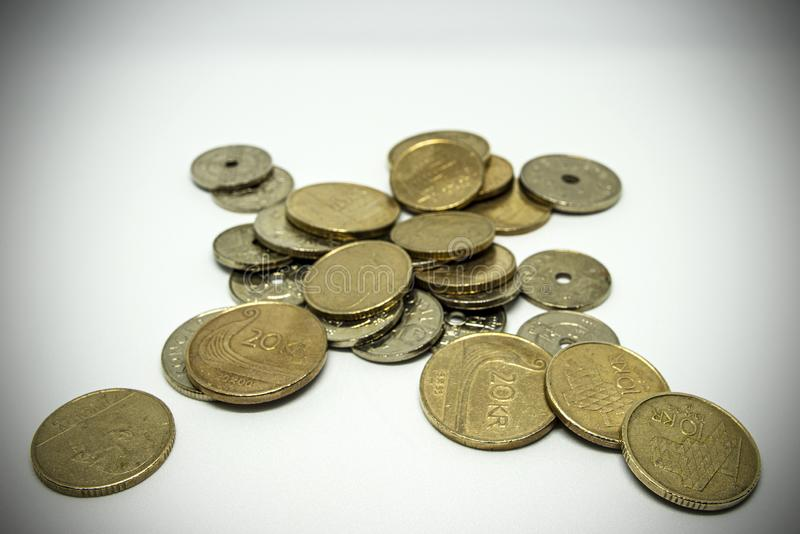 Bronze and silver colored coins spread out on a table. stock photo
