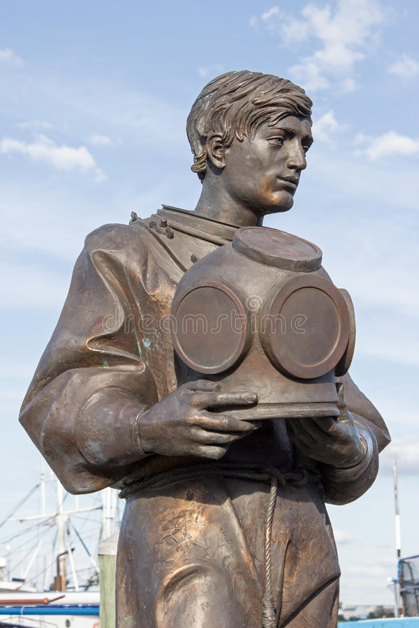 Bronze Sponge Diver Upper. Sculpture of Bronze Sponge Diver Dressed in His Diving Suite and Holding His Metal Diving Helmet stock image