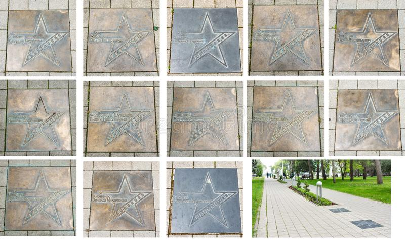 Bronze star plates with the names of Russian movie stars and Star Avenue of movie actors near the central square near the stock photos