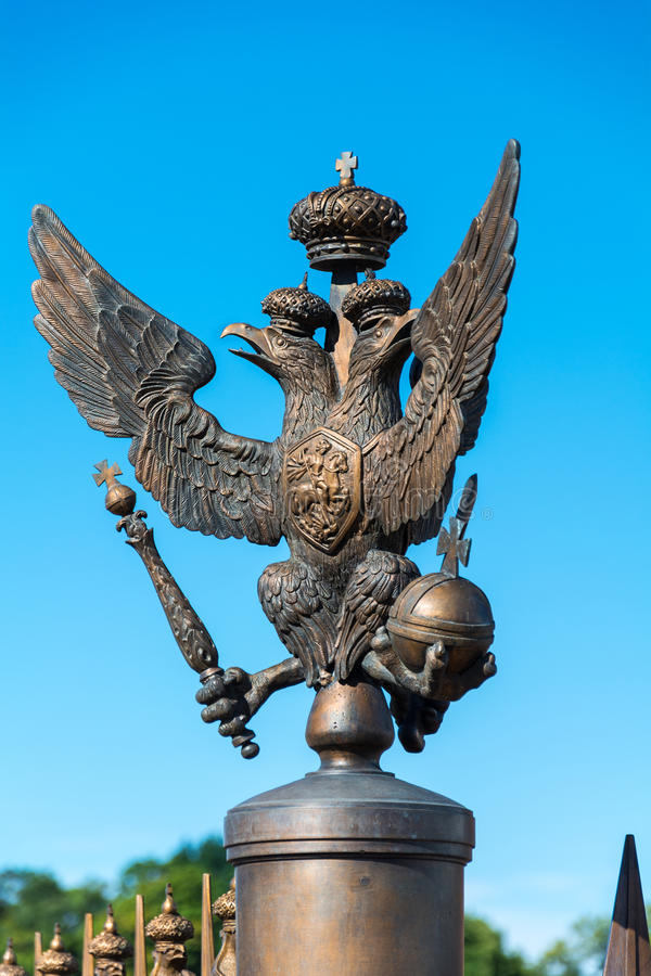 Bronze State two-headed eagle on the fence of the Alexander Column on The Palace Square in St. Petersburg stock photos