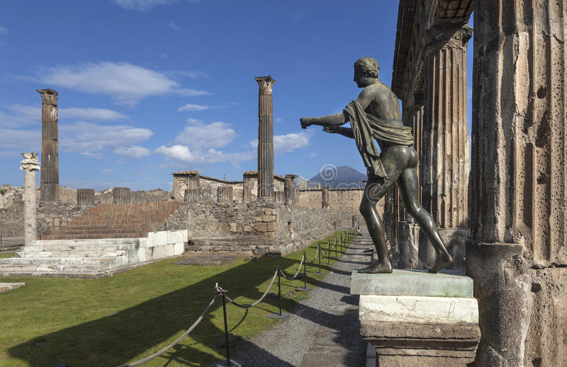 Bronze statue of Apollo in ruins of Pompeii royalty free stock images