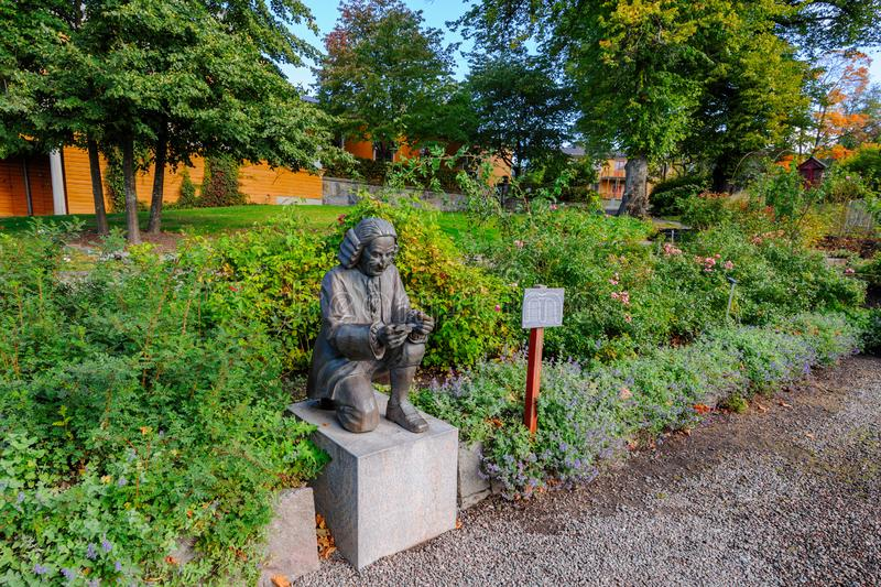 Bronze statue of Carl Nilsson Linnaeus 1707-1778, Swedish botanist, zoologist, and physician, in rose garden at Skansen Open-Air royalty free stock images