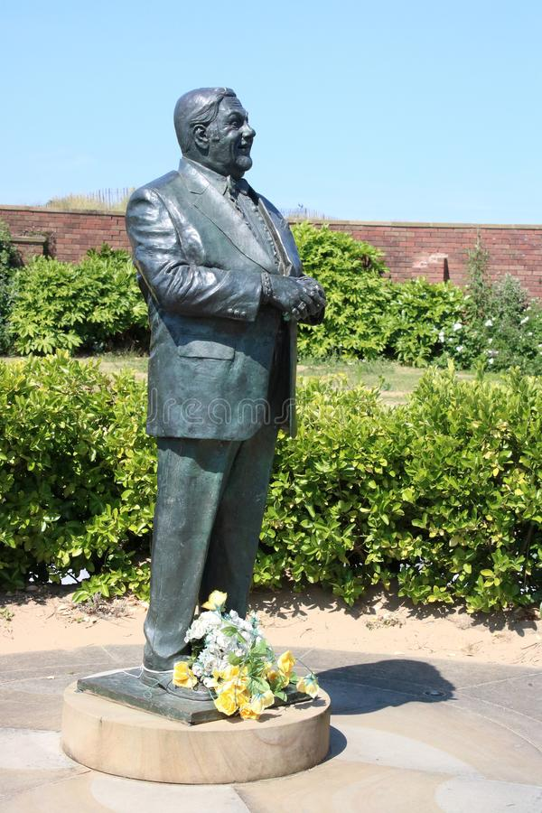 Bronze statue of comedian Les Dawson in St Annes. Bronze statue of comedian Les Dawson in the Peace and Happiness Garden on the seafront in St Annes-on-the-Sea royalty free stock photos