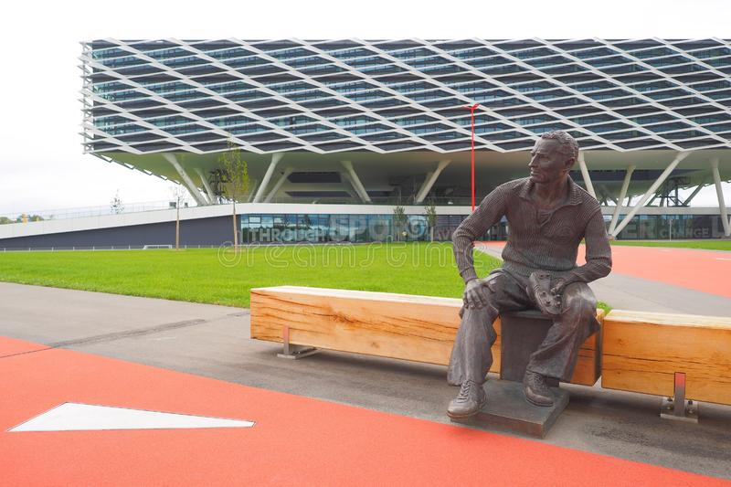 Herzogenaurach, Germany - August 19, 2019:  Bronze statue of company founder Adi Dassler in front of the new Adidas Headquarter in. Bronze statue of company stock photography