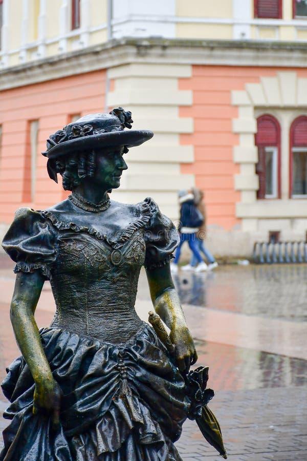 Bronze statue of elegant woman stock image