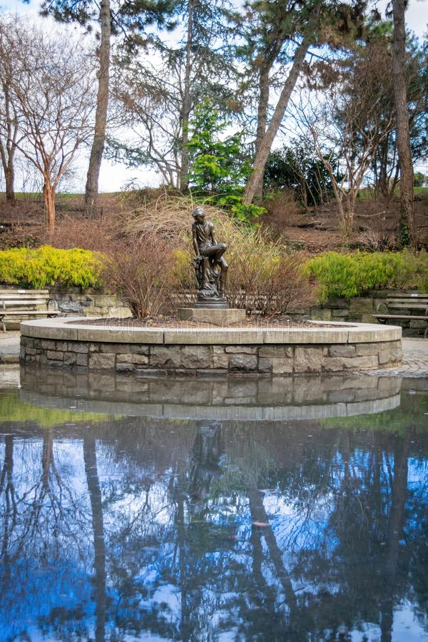 A bronze statue of that famous youth, Peter Pan, at Carl Schurz Park in New York City, NY, USA stock image