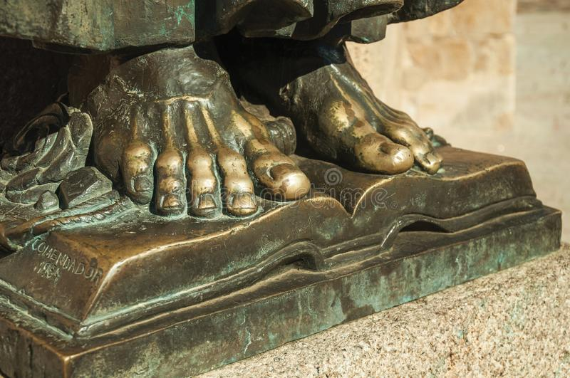 Bronze statue of feet over open book at Caceres stock photos