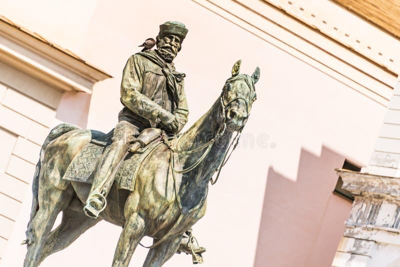 The statue of Giuseppe Garibaldi on horse, Genoa Piazza de Ferrari, in the centre of Genoa, Liguria, Italy [t. The bronze statue of Giuseppe Garibaldi on horse stock photo