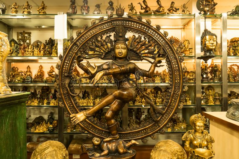 Bronze statue of indian goddess Shiva Nataraja - Lord of Dance. Antique shop in new Delhi. 7 January 2018 royalty free stock photography