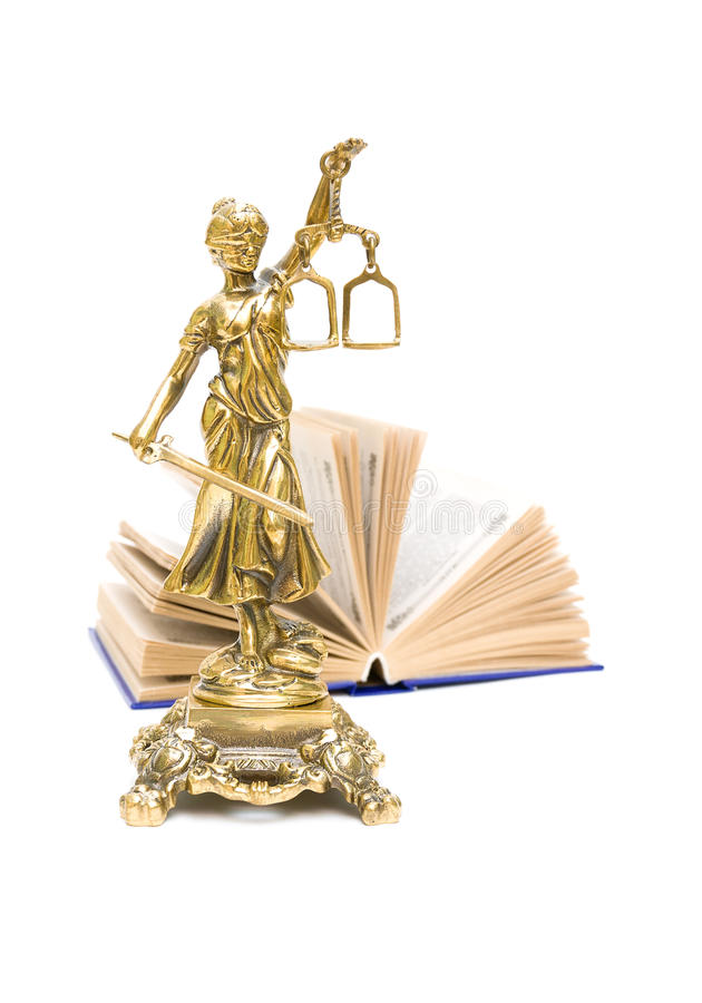 Bronze statue of Justice and the book. vertical photo. Bronze statue of justice and book isolated on white background. vertical photo stock images
