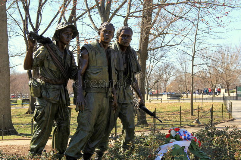 Bronze statue known as 'The Three Soldiers',a compliment to the Vietnam Veterans Memorial,Washington,DC,2015. Moving, life-like bronze statue known as ' The royalty free stock photos
