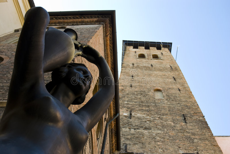 Bronze statue in Padova, Italy. Low angle detail of a bronze statue of barechest woman in Padova, Italy stock image