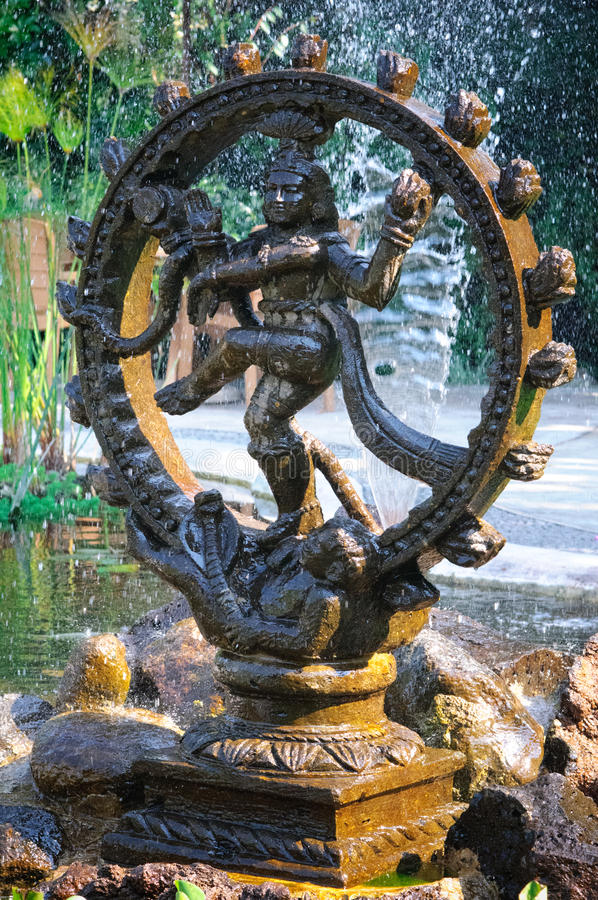 Bronze statue of Shiva. Bronze statue indian goddess Shiva Nataraja - Lord of Dance in a fountain with papyrus plant stock images
