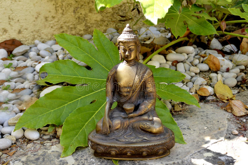 Bronze statue of Touching earth Buddha royalty free stock photo