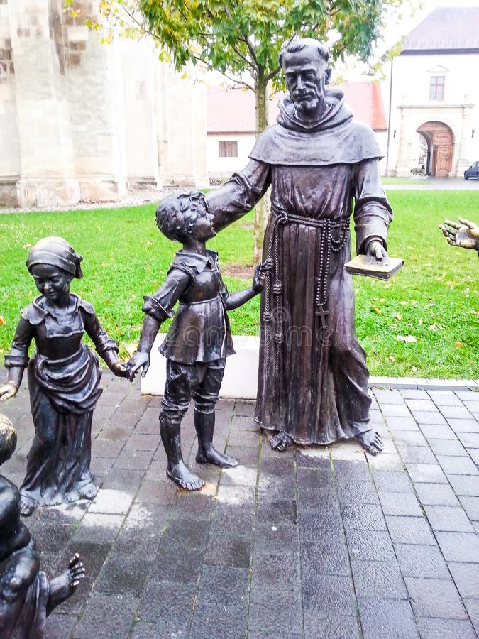 Bronze statue of woman and kids royalty free stock photo