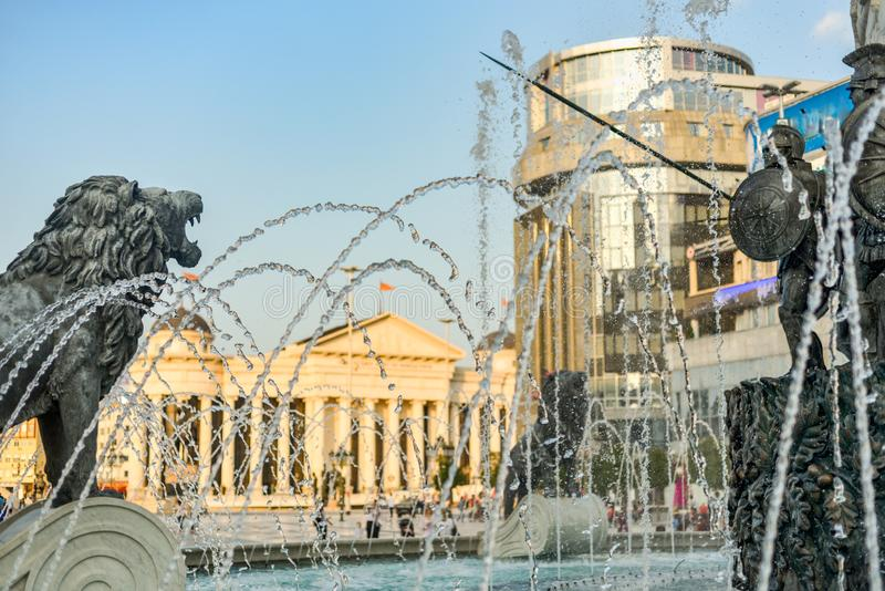 Bronze statues of historical figures surrounded by spray and water jets,Skopje,Macedonia. SKOPJE/NORTH MACEDONIA-AUGUST 28 2018:Water jets,statues and spray at stock photos