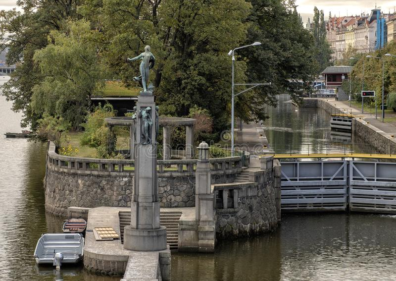 Bronze statues of naked women on a stone column, Vlatava River near Lesser Town side Legion Bridge, Prague. Pictured is a stone column with bronze statues of royalty free stock photos