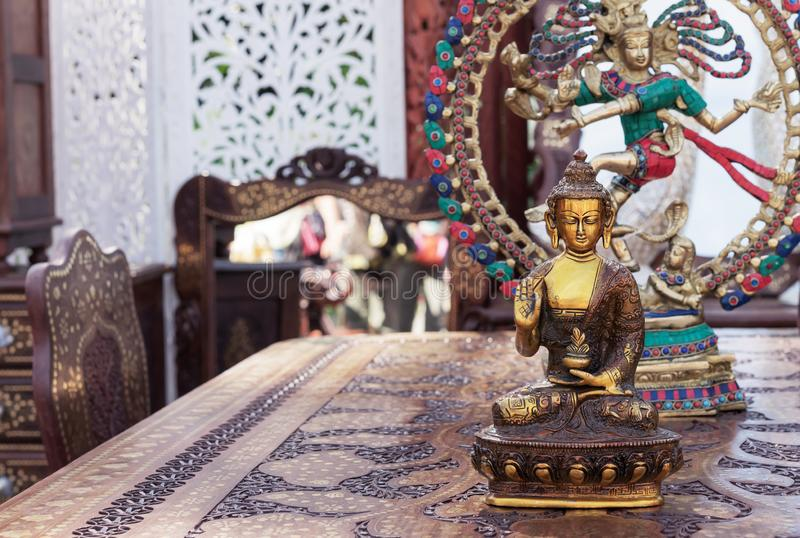 Bronze statuette of a meditating Buddha. Statuette of blessing Buddha stock images