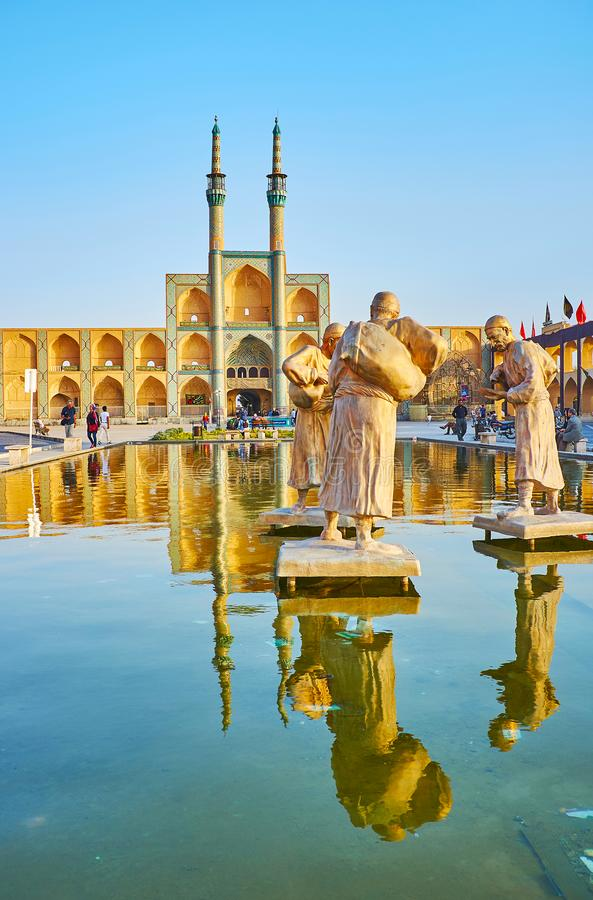 Bronze water carriers in Amir Chakhmaq Square, Yazd, Iran. YAZD, IRAN - OCTOBER 18, 2017: The bronze sculptural composition of water carriers in fountain of Amir stock photos