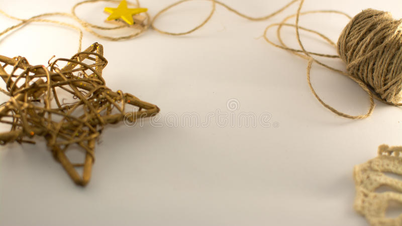 Bronze wicker star , ropes of burlap on the white background royalty free stock images