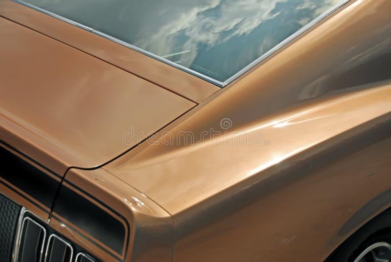 Bronzemuskel-Auto-Detail stockbilder
